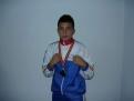 SIMESCU CLAUDIU 15 ani 1 medalia aur, 1 medalie argint, 3 medalii bronz